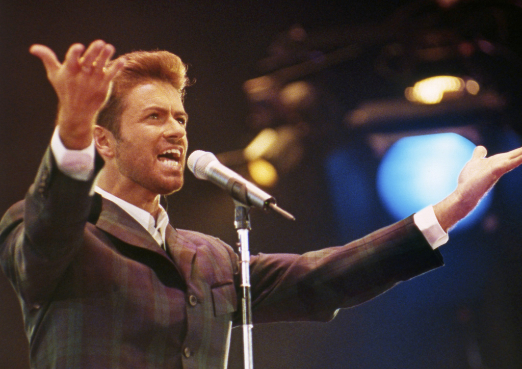 """FILE - In this Dec. 2, 1993 file photo, George Michael performs at """"Concert of Hope"""" to mark World AIDS Day at London's Wembley Arena. ..."""