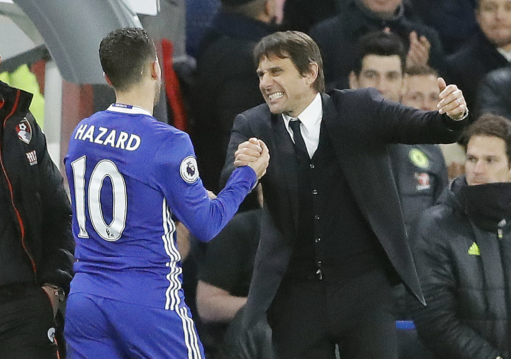 Chelsea's Eden Hazard, left, and Chelsea's team manager Antonio Conte celebrate after winning the English Premier League soccer match b...