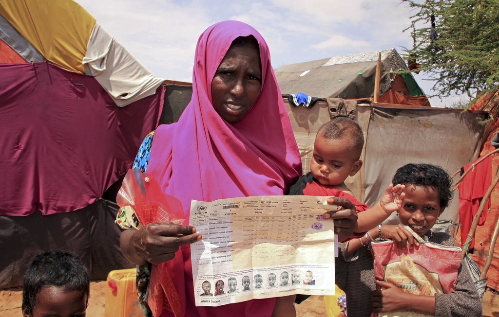 In this photo taken Wednesday, Nov. 16, 2016, Somali refugee and mother of six Madino Dhurow, who was repatriated to Somalia from Kenya...