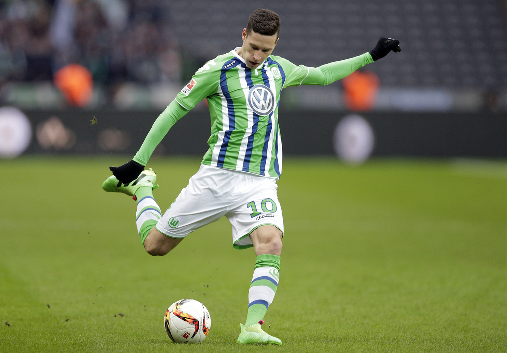 FILE - In this Feb. 20, 2016 file picture, Wolfsburg's Julian Draxler plays the ball during the German Bundesliga soccer match between ...
