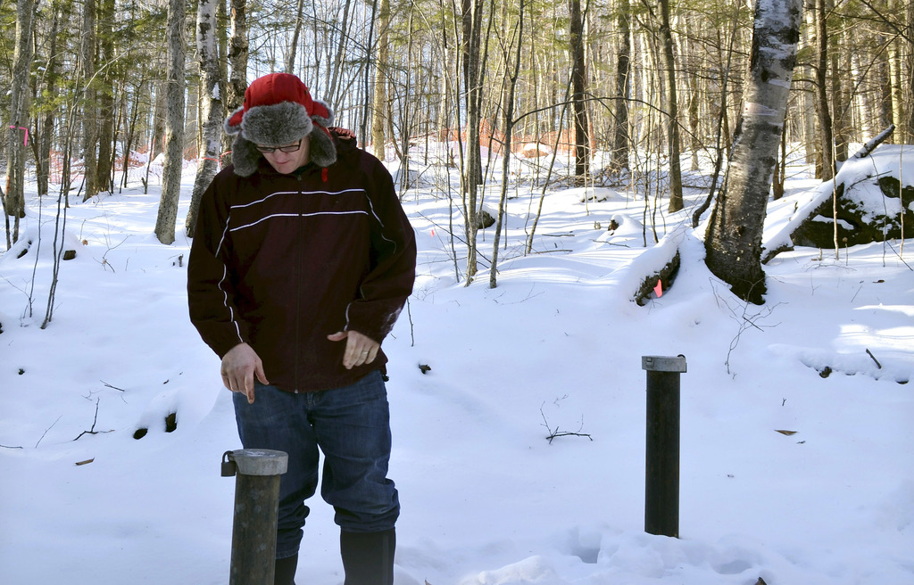 In this Friday, Dec. 16, 2016 photo, Richard Higgins, whose family's well water has been contaminated by a suspected carcinogen from a ...