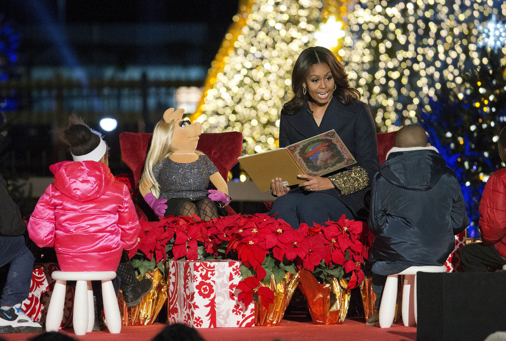 FILE - In this Dec. 3, 2015, file photo, first lady Michelle Obama with Miss Piggy, left, read 'Twas the Night Before Christmas for chi...