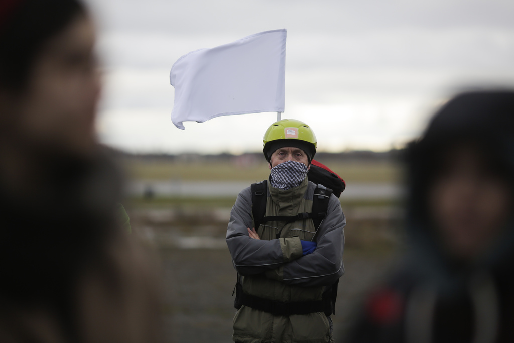 A demonstrator  with white flag waits for the launch of the Civil March for Aleppo at the air field of the former airport Tempelhof in ...