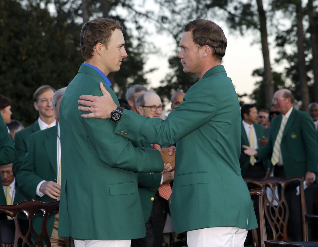 FILE- In this April 10, 2016 file photo, defending champion Jordan Spieth, left, shakes hands with Masters champion Danny Willett, of E...