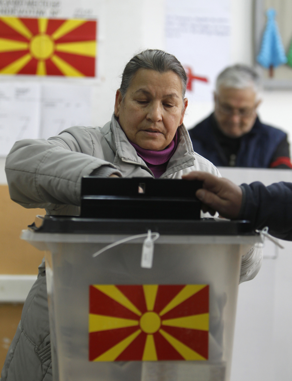 A woman casts her ballot at a polling station in village of Tearce, in northwestern Macedonia, on Sunday, Dec. 25, 2016. Authorities in...