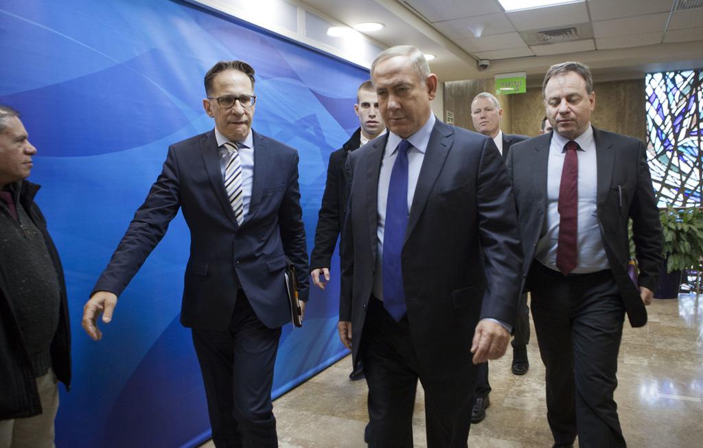 Israeli Prime Minister Benjamin Netanyahu, second right, arrives for a weekly cabinet meeting in Jerusalem, Sunday, Dec. 25, 2016. (Dan...