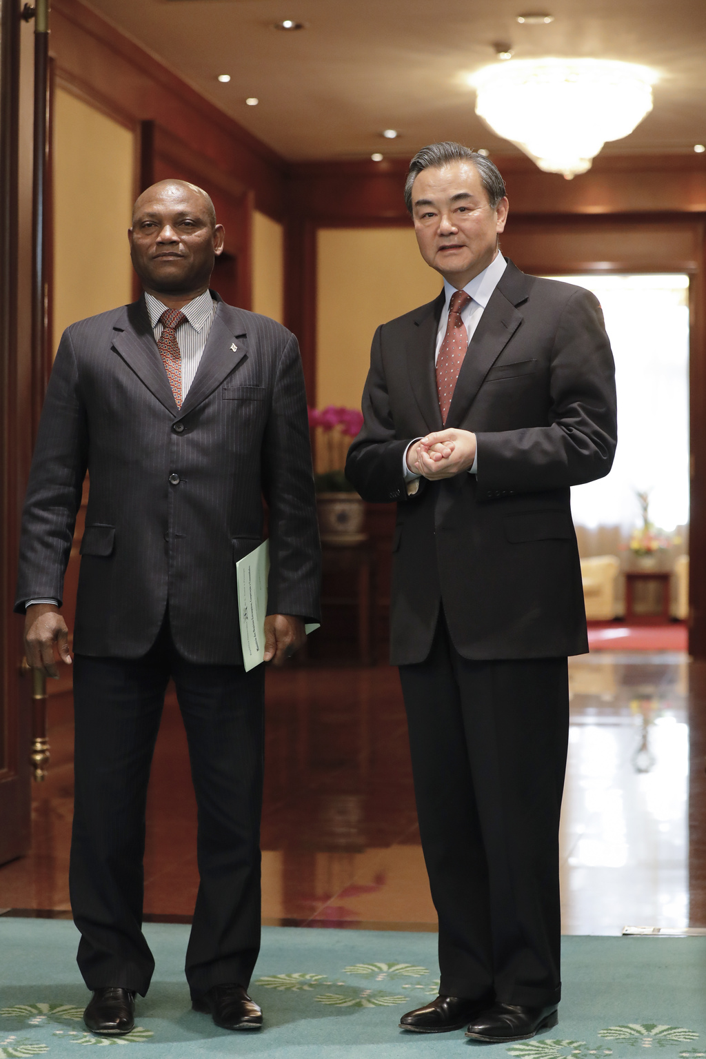 Chinese Foreign Minister Wang Yi, right, stands with his Sao Tome counterpart Urbino Botelho after a signing ceremony at the Diaoyutai ...