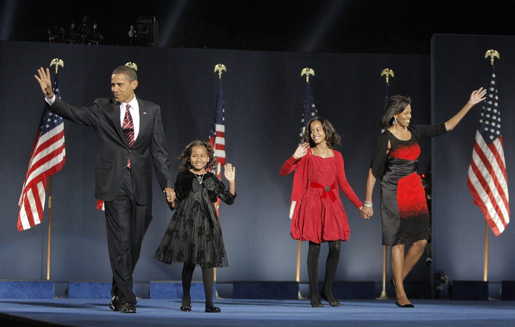 FILE - In this Nov. 4, 2008, file photo, then-President-elect Barack Obama, left, his wife Michelle Obama, right, and daughters, Malia,...