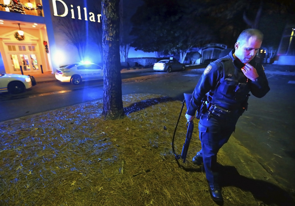 Memphis police officers block off the entrances to the Oak Court Mall on Monday, Dec. 26, 2016, after a disturbance at the mall in Memp...