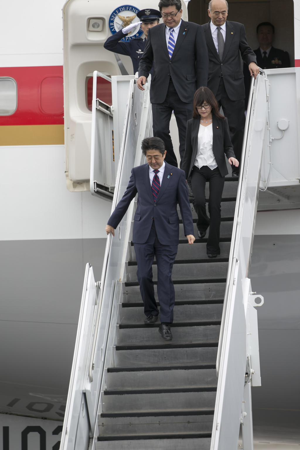 Japan's Prime Minister Shinzo Abe arrives at Joint Base Pearl Harbor Hickam, Monday, Dec. 26, 2016, in Honolulu. Abe will visit Pearl H...
