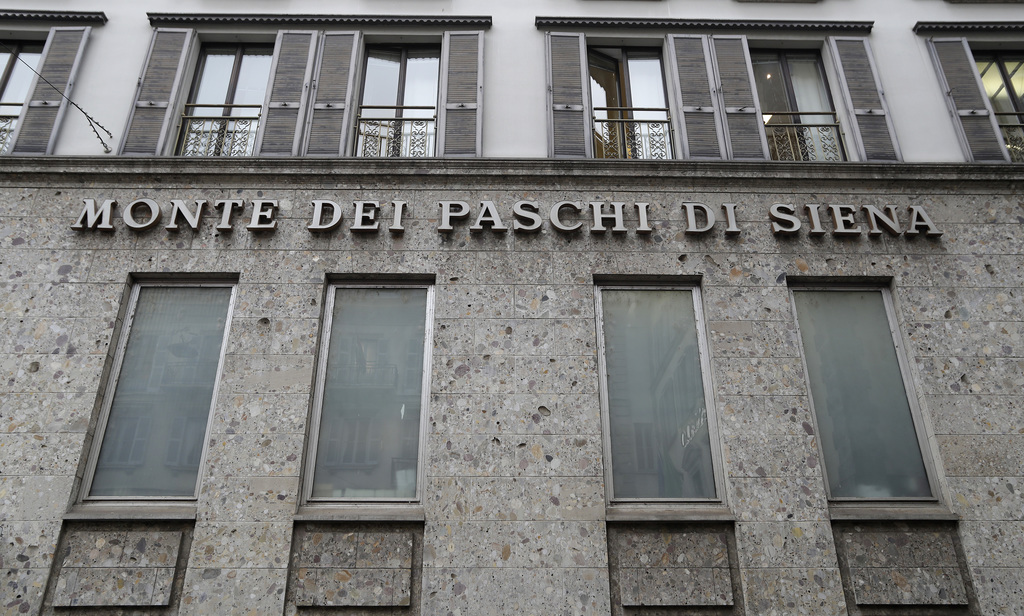 FILE - In this file photo dated Monday, Dec. 19, 2016, the facade of a branch of the ' Monte Dei Paschi di Siena ' bank in Milan, Italy...