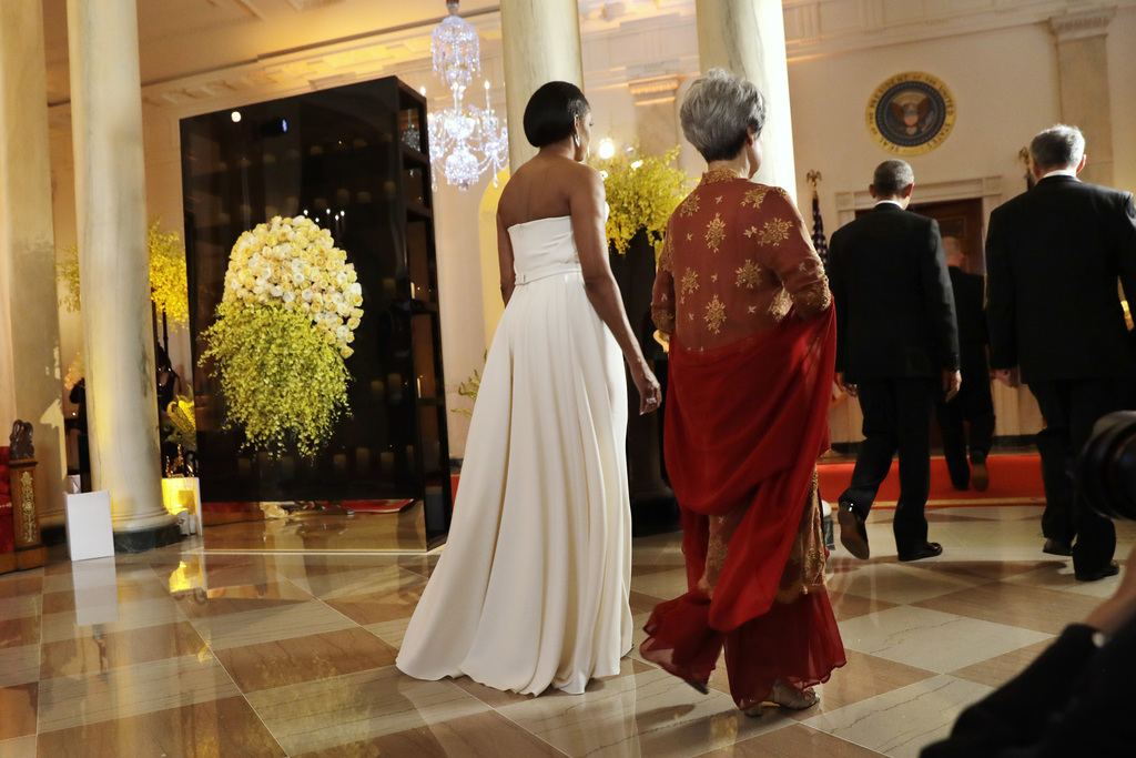 FILE - In this Aug. 2, 2016, file photo, first lady Michelle Obama, left, and Ho Ching, wife of Singapore's Prime Minister Lee Hsien Lo...