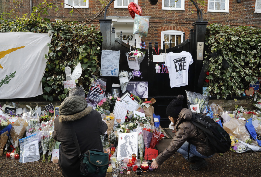 People mourn outside the home of British musician George Michael in London, Tuesday, Dec. 27, 2016. George Michael, who rocketed to sta...