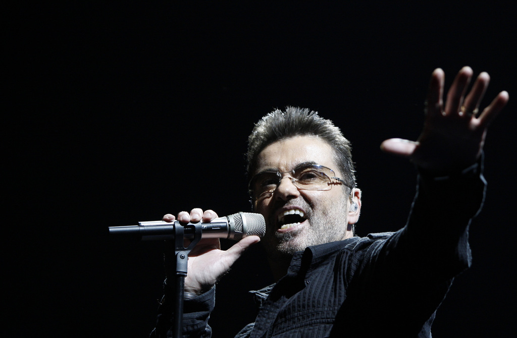 """FILE- In this June 25, 2008, file photo, singer George Michael performs during his """"Live Global Tour"""" concert in Inglewood, Calif. Mich..."""