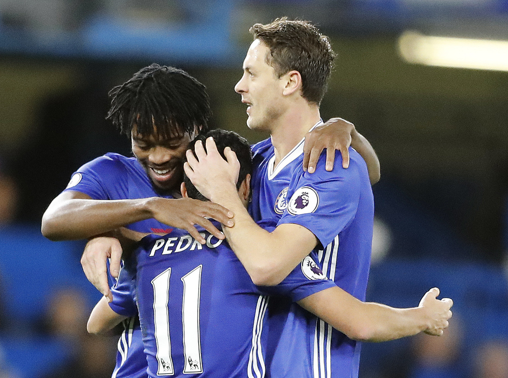 Chelsea's Pedro, center, celebrates with teammates after scoring during the English Premier League soccer match between Chelsea and Bou...