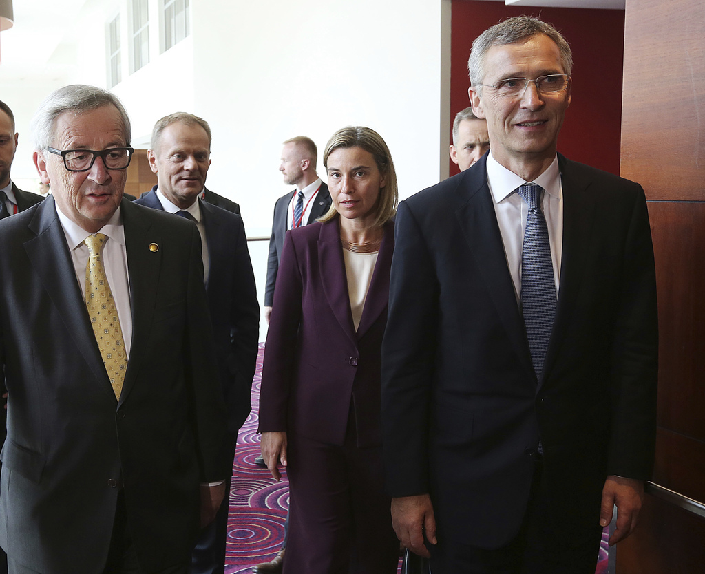 FILE - In this Friday, July 8, 2016 file photo, President of European Commission Jean-Claude Juncker, left, President of the European C...