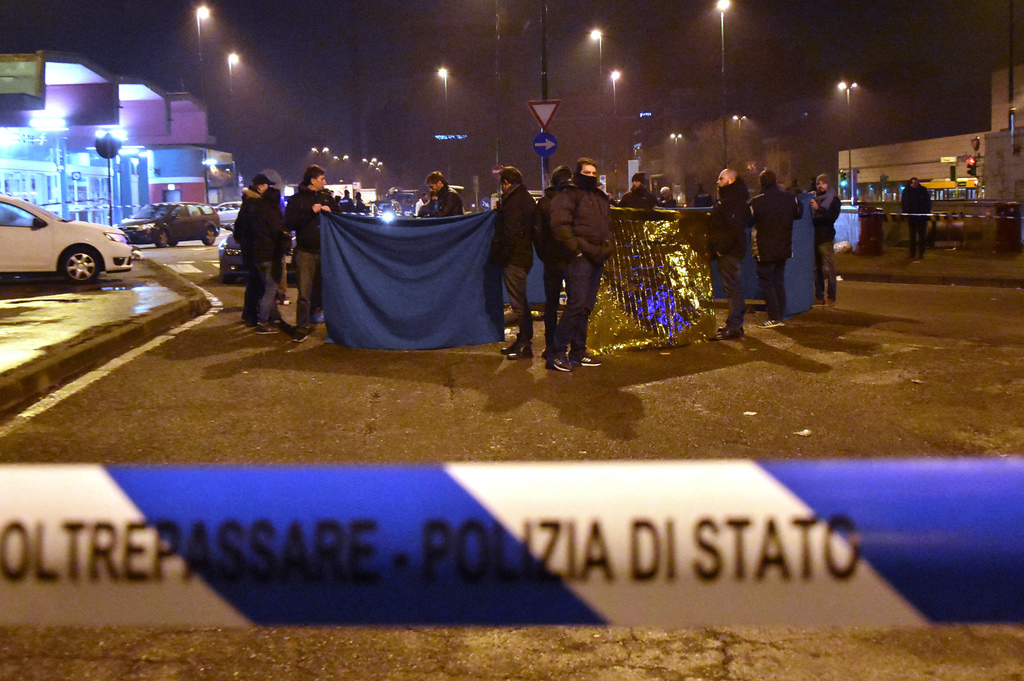 Italian Police cordon off an area after a shootout between police and a man near a train station in Milan's Sesto San Giovanni neighbor...