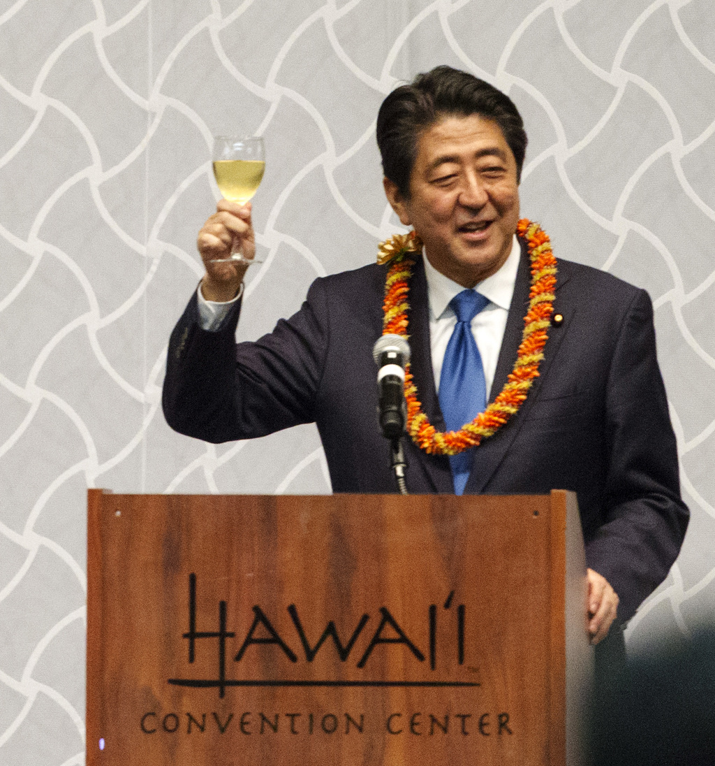 Japanese Prime Minister Shinzo Abe offers a toasts to guests at a dinner held in Abe's honor, Monday, Dec. 26, 2016, in Honolulu. Abe l...