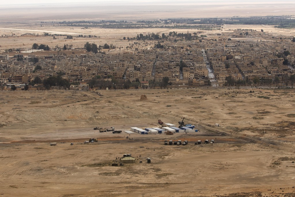 FILE - In this April 14, 2016, file photo, a Russian military camp is seen at the ancient city of Palmyra in the central city of Homs, ...