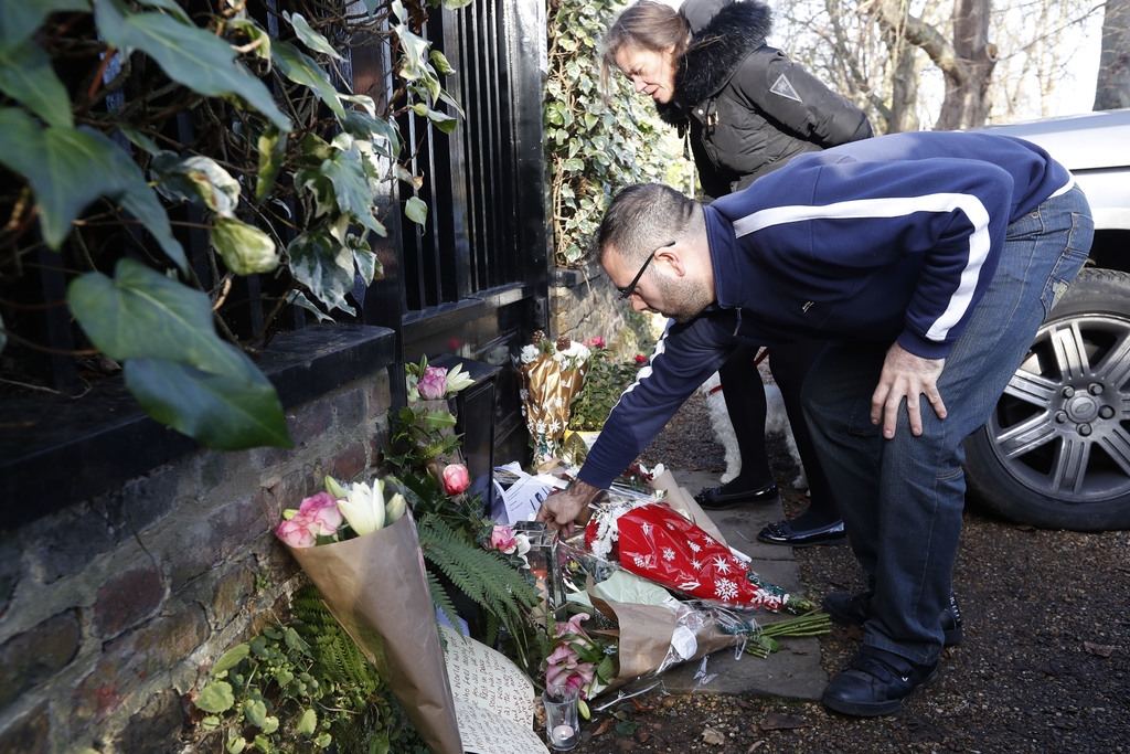 Fans leave tributes outside the home of British musician George Michael in London, Monday, Dec. 26, 2016. George Michael, who rocketed ...