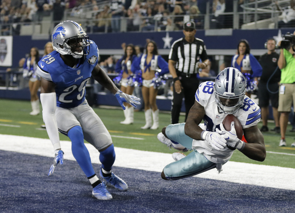 Detroit Lions' Johnson Bademosi (29) is unable to stop Dallas Cowboys' Dez Bryant (88) from catching a touchdown pass late in the first...
