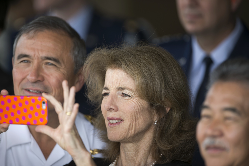 Caroline Kennedy, U.S. Ambassador to Japan, center, takes a picture as U.S. Adm. Harry Harris, United States Pacific Command, left, and...