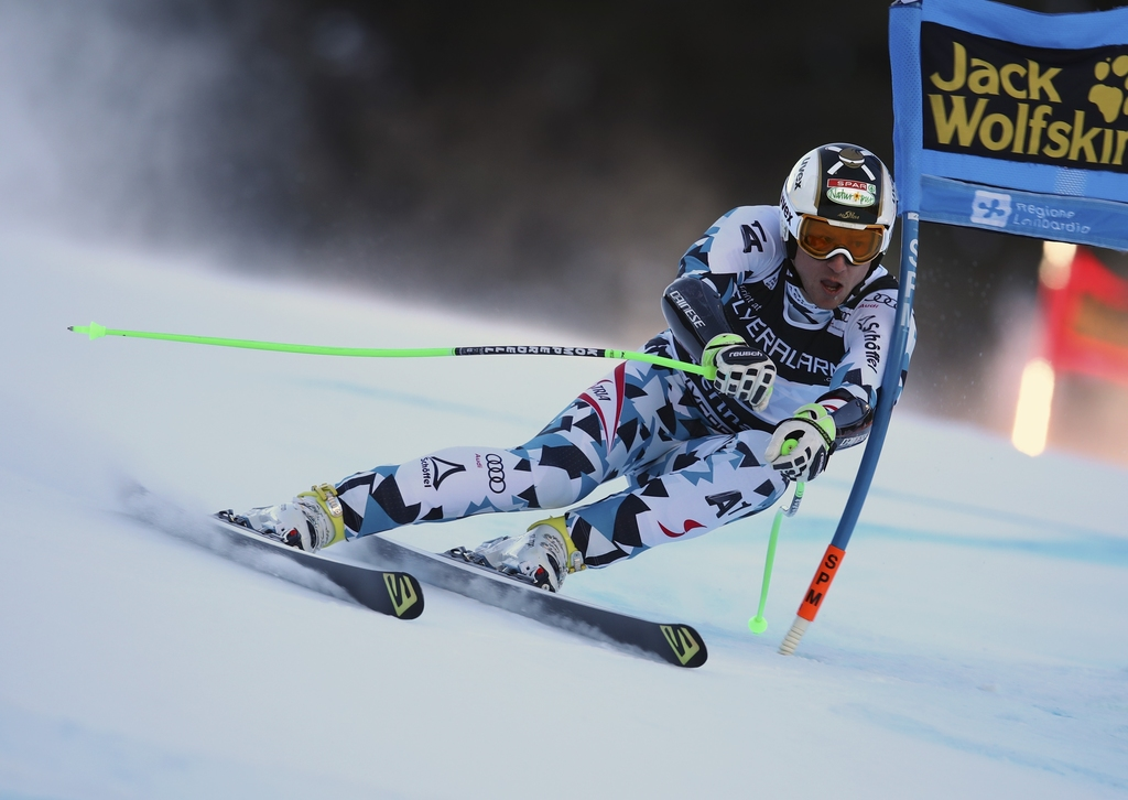 Austria's Hannes Reichelt speeds down the course during an alpine ski, mens' World Cup Super G, in Santa Caterina, Italy, Tuesday, Dec....