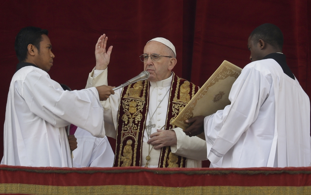 Pope Francis delivers the Urbi et Orbi (Latin for ' to the city and to the world' ) Christmas' day blessing from the main balcony of St...