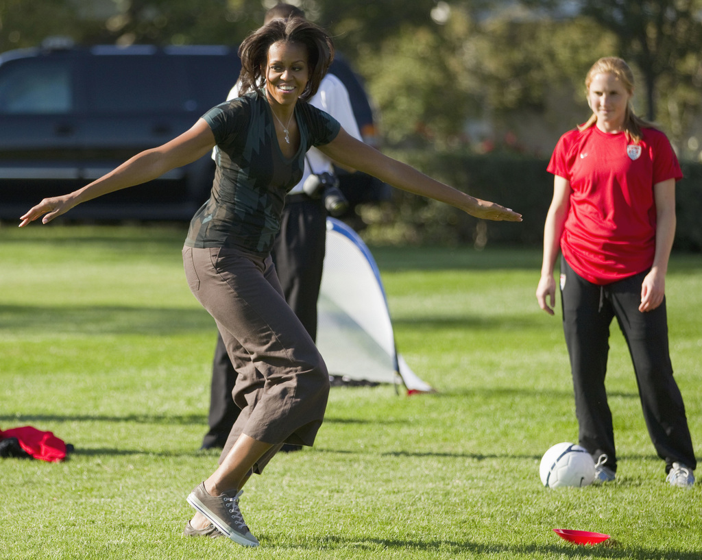 FILE - In this Oct. 6, 2011, file photo, first lady Michelle Obama plays soccer on the South Lawn of the White House in Washington, as ...