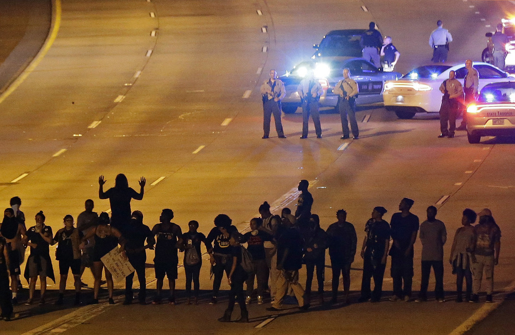 FILE - In this Sept. 22, 2016 file photo, police confront protesters blocking Interstate-277 during demonstrations following the police...
