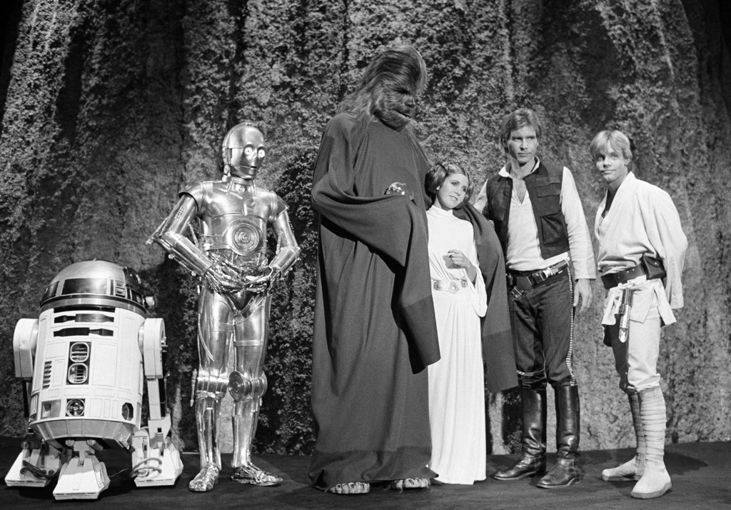 FILE - In this Nov. 13, 1978 file photo, shows, from left, Kenny Baker, Anthony Daniels, Peter Mayhew, Carrie Fisher, Harrison Ford, an...
