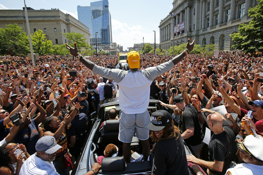 FILE - In this June 22, 2016 photo, Cleveland Cavaliers' LeBron James, center, stands in the back of a Rolls Royce as it makes its way ...