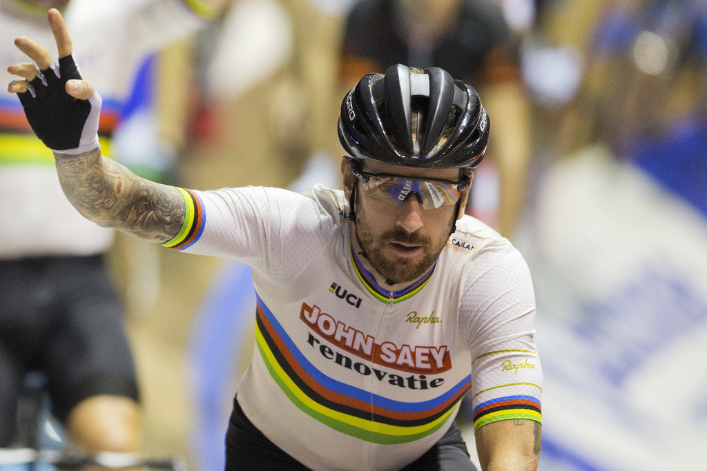 FILE - In this Sunday, Nov. 20, 2016 file photo, former Tour de France winner and Olympic Gold medalist Britain's Bradley Wiggins greet...