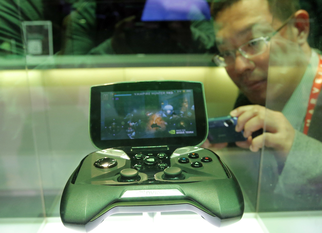 FILE - In this Tuesday, Jan. 8, 2013, file photo, Nvidia's portable handheld gaming device, the Project Shield, is on display at the co...