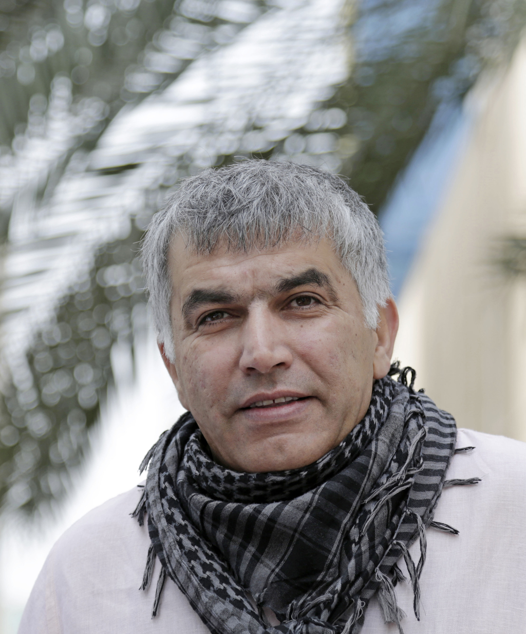 FILE -- In this Feb. 11, 2015 file photo, Nabeel Rajab, one of Bahrain's best-known human rights activists, walks toward the courthouse...