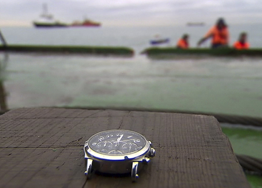 In this frame grab made available by Russian Rossiya One TV Channel on Wednesday, Dec. 28, 2016 a wristwatch lifted by divers is recove...