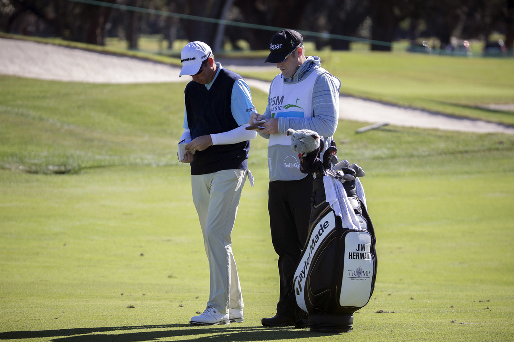 FILE - In a Sunday, Nov. 20, 2016 file photo, Jim Herman, right, and his caddie plan his shot on the first fairway during the final rou...