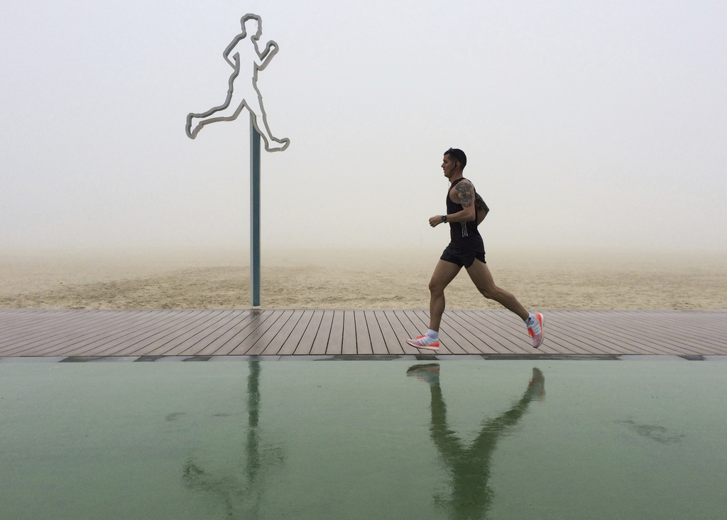 A man jogs in the fog at the Umm Suqeim beach in Dubai, United Arab Emirates, Wednesday, Dec. 28, 2016. A heavy seasonal fog engulfed t...