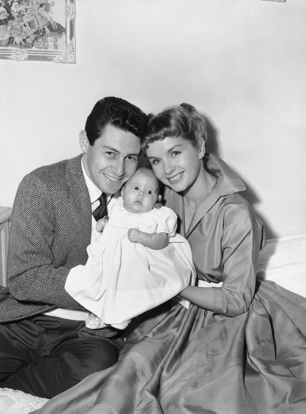 FILE - In this Jan. 2, 1957 file photo, Eddie Fisher and Debbie Reynolds hold their baby daughter, Carrie Frances Fisher, as the pose f...
