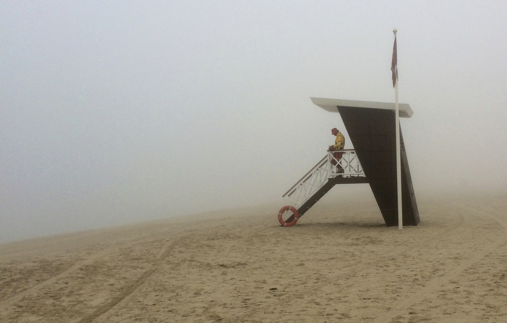 A lifeguard looks out at the fog covered empty Umm Suqeim beach, in Dubai, United Arab Emirates, Wednesday, Dec. 28, 2016. A heavy seas...