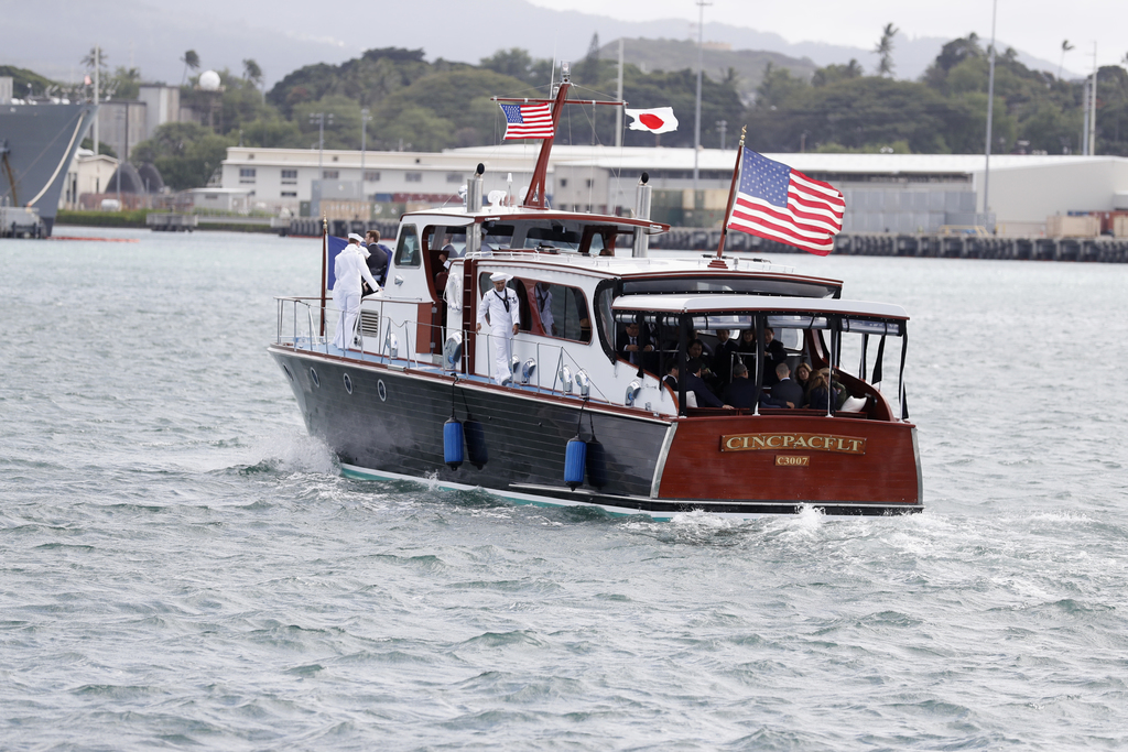 President Barack Obama and Japanese Prime Minister Shinzo Abe ride in the stern of the CINCPACFLT (Commander in Chief Pacific Fleet Bar...