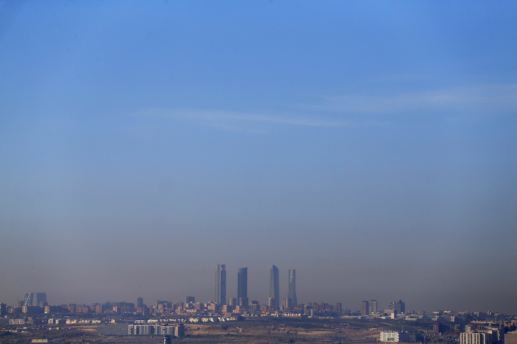 In this photo taken on Thursday, Dec. 3, 2015, a layer of smog covers the four towers that mark Madrid's skyline in Madrid, Spain. Madr...