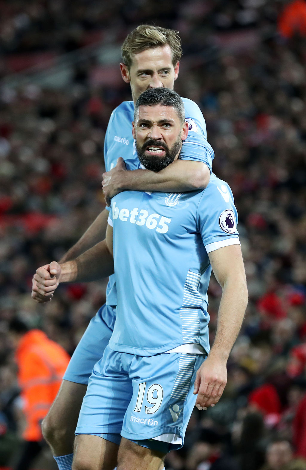 Stoke City's Jonathan Walters, front, celebrates scoring his side's first goal of the game during their English Premier League soccer m...