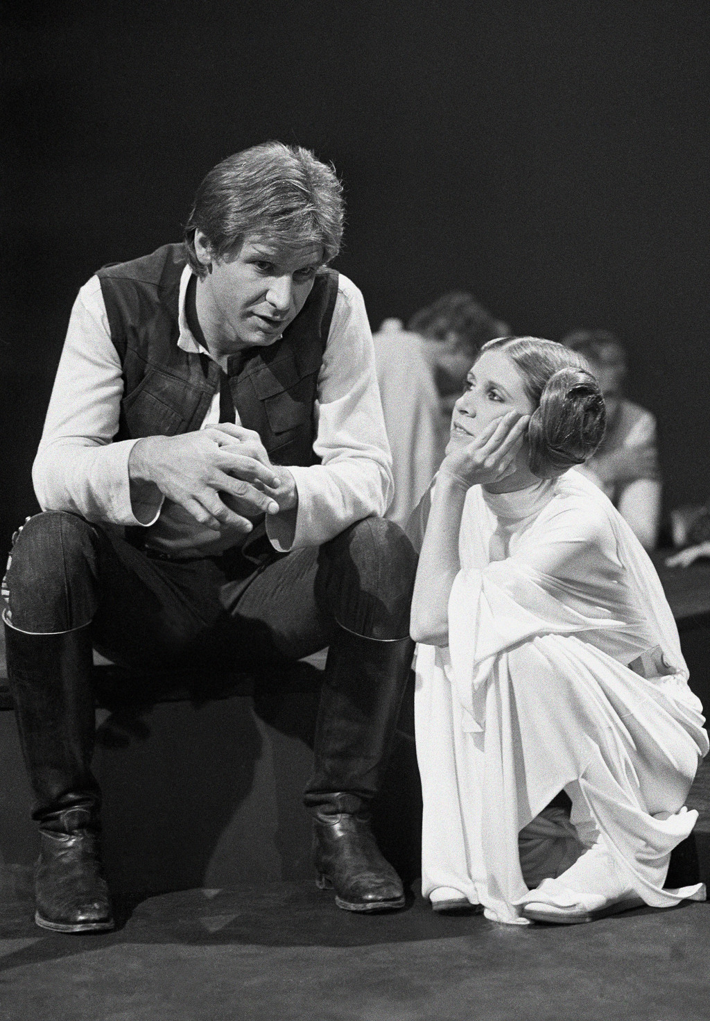 "FILE - In this Nov. 13, 1978 file photo, Harrison Ford talks with Carrie Fisher during a break in the filming of the CBS-TV special ""Th..."