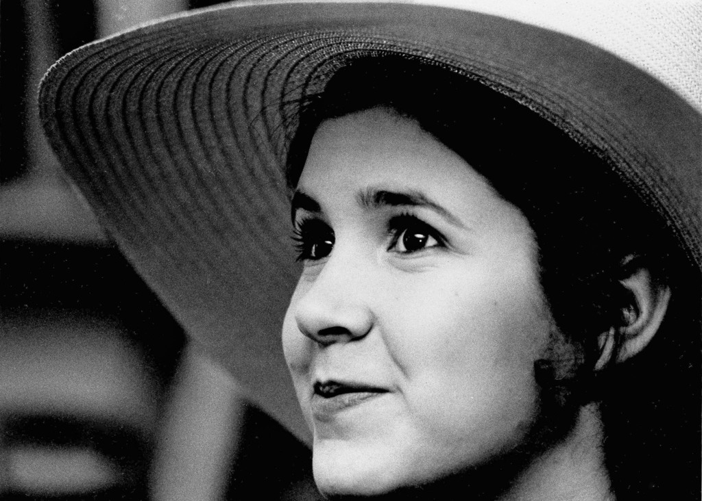 FILE - This May 2, 1973 file photo shows Carrie Fisher, the 16-year-old daughter of Debbie Reynolds and Eddie Fisher, in New York. On T...