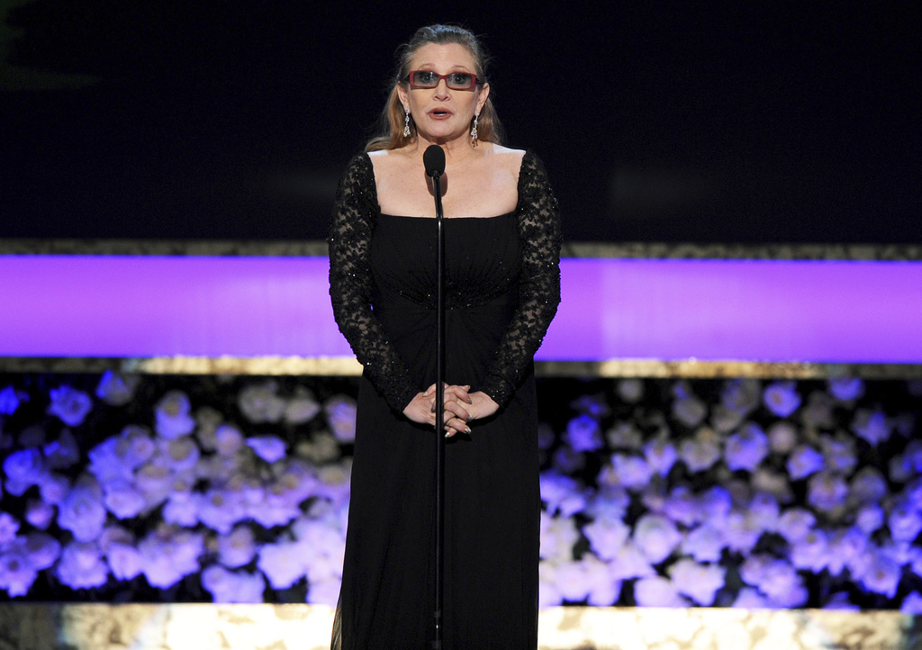 FILE - In this Sunday, Jan. 25, 2015 file photo, Carrie Fisher presents the life achievement award on stage at the 21st annual Screen A...