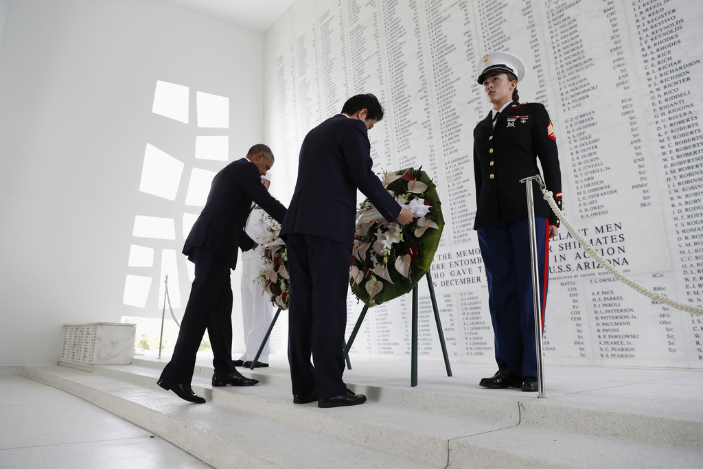President Barack Obama and Japanese Prime Minister Shinzo Abe participate in a wreath laying ceremony at the USS Arizona Memorial, part...