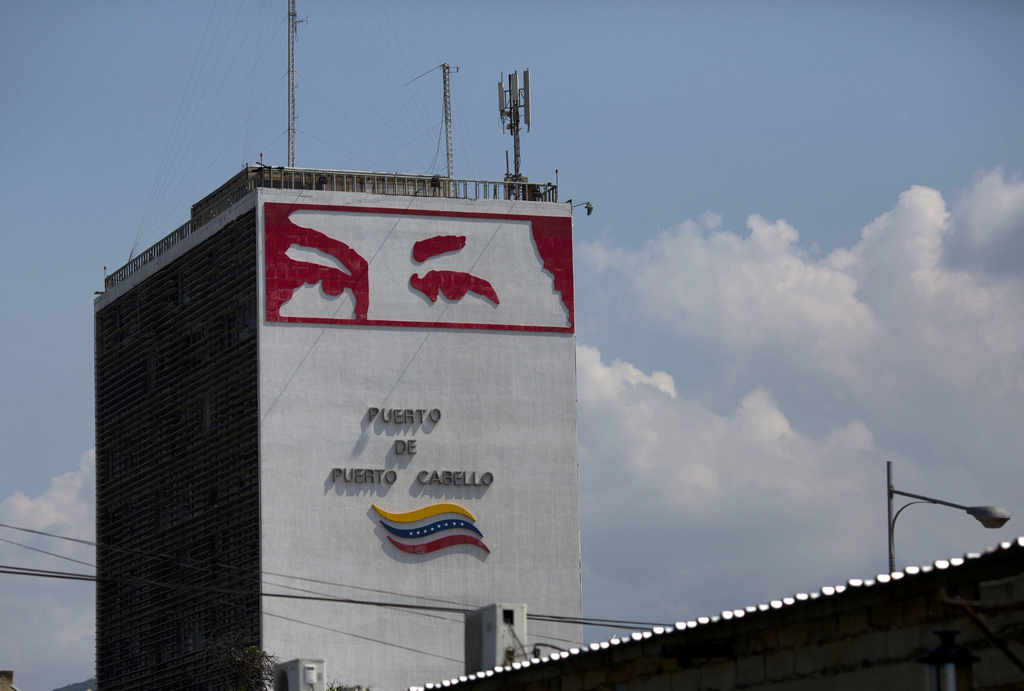 In this Nov. 1, 2016, the eyes of late Venezuelan President Hugo Chavez cover a tower at the port in Puerto Cabello, Venezuela. In July...