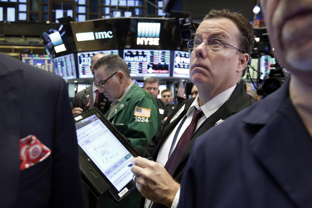 FILE - In this Thursday, Oct. 27, 2016, file photo, trader Joseph Murray works on the floor of the New York Stock Exchange. After reapi...