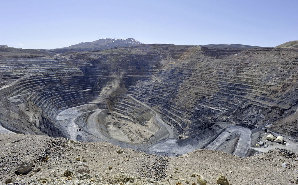 FILE - This April 4, 2012, file photo shows the Newmont Gold Quarry pit in Battle Mountain, Nev. The price of gold rose 7 percent in 20...
